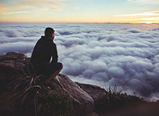 man looking over clouds